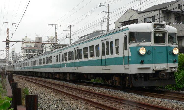 地上時代の南田辺駅付近を行く113系F409編成+カフェオレ編成